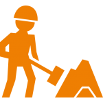 worker-of-construction-working-with-a-shovel-beside-material-pile